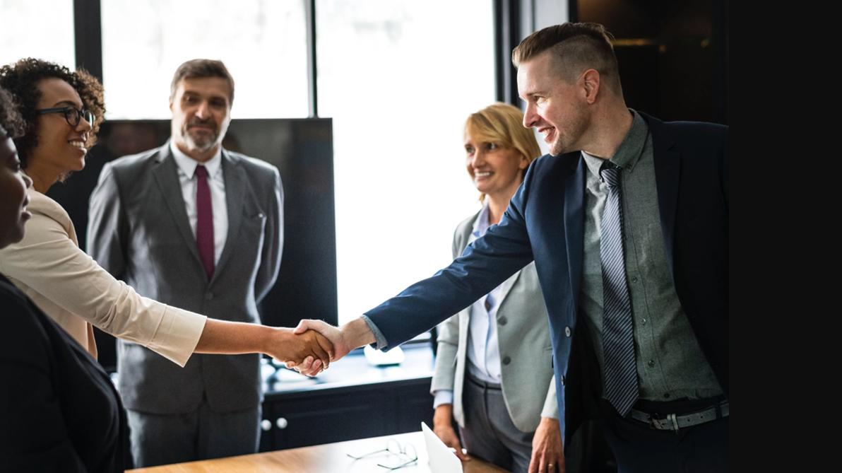 Sales representatives closing a deal