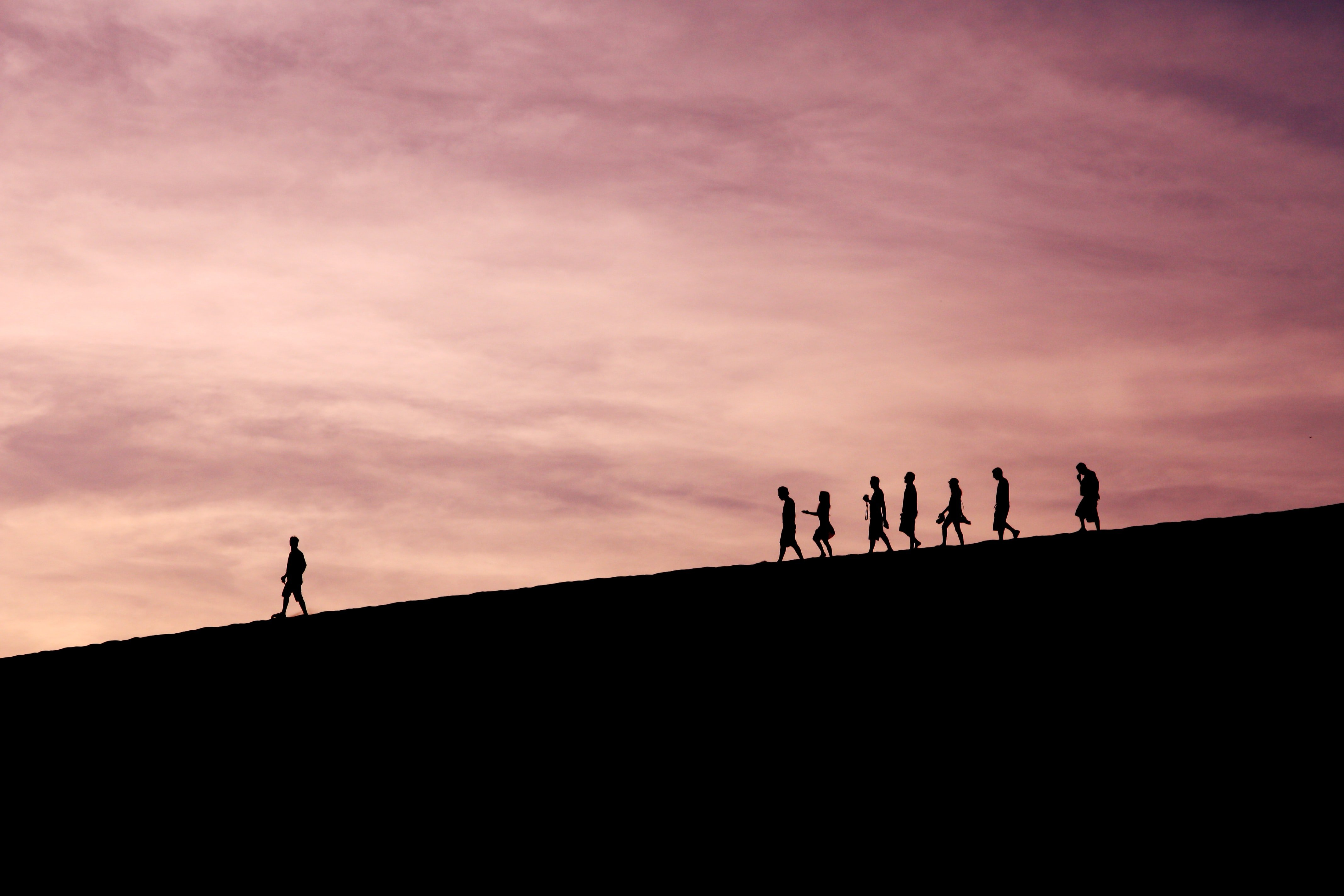 people walking in line on top of a hill; pre-employment assessment