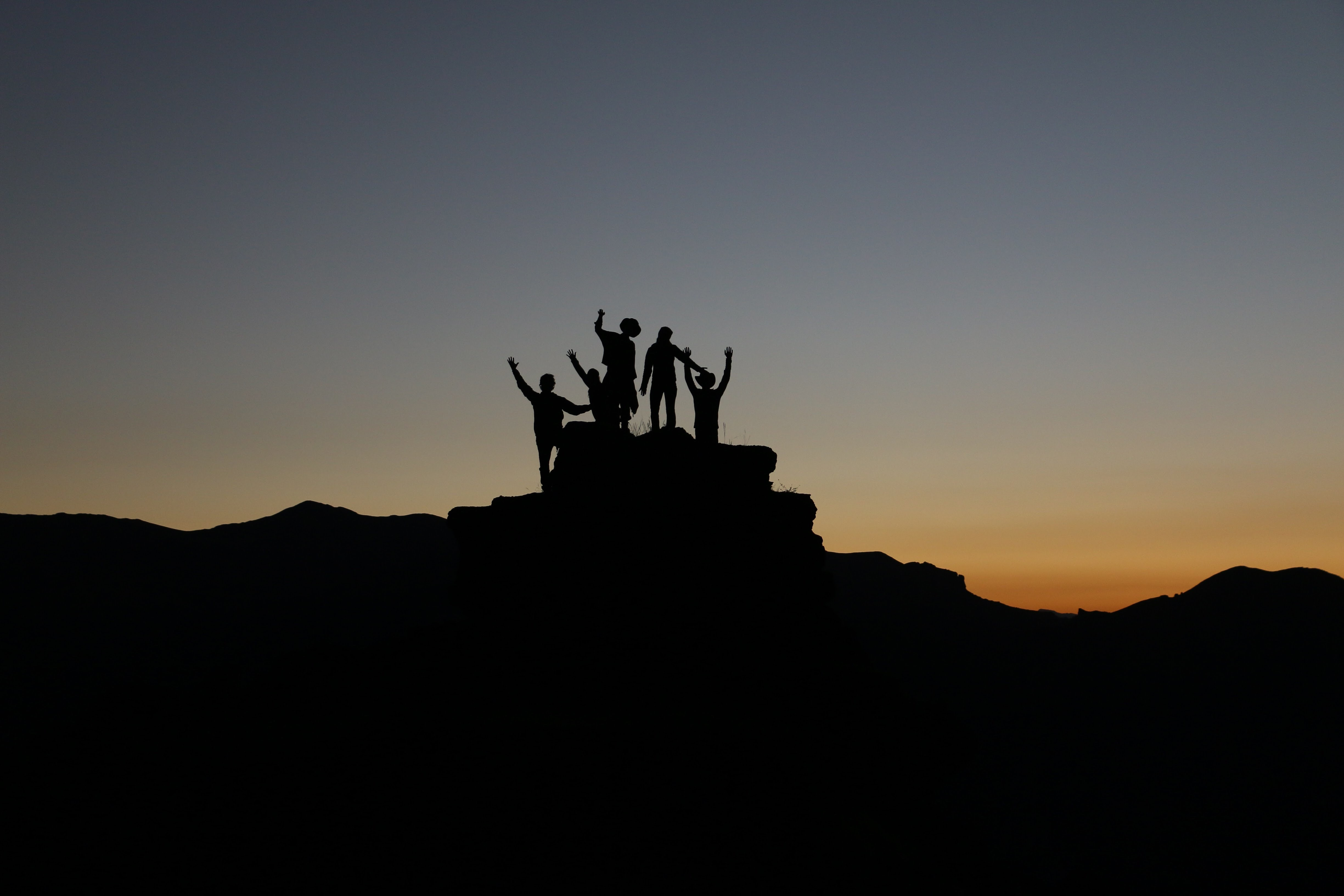 group of people standing on top of a mountain; pre-employment assessment