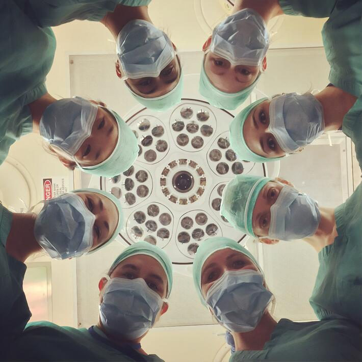 Group of Doctors in a circle ; Healthcare recruiting