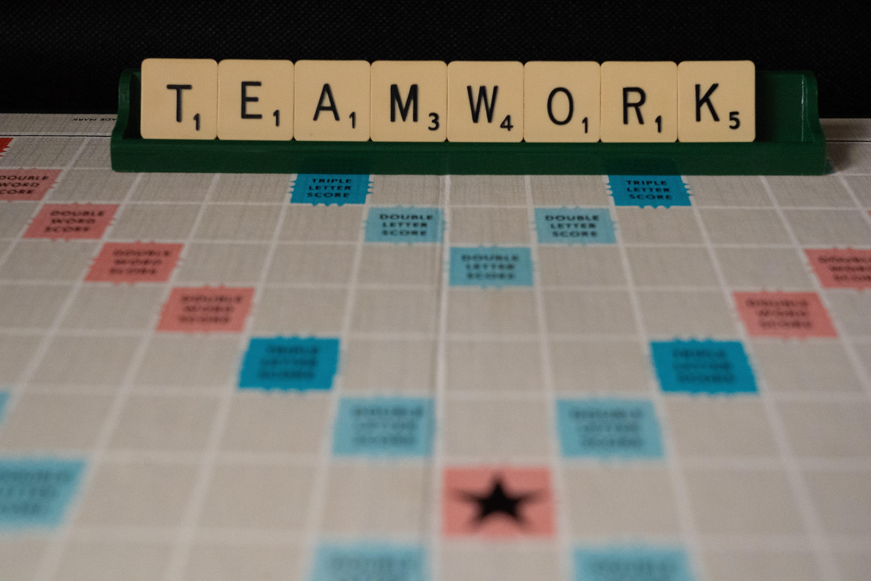 scrabble board spelling the word teamwork; pre-employment assessment