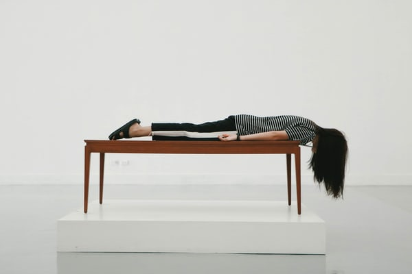 Girl lying on the table- pre-employement-assessment