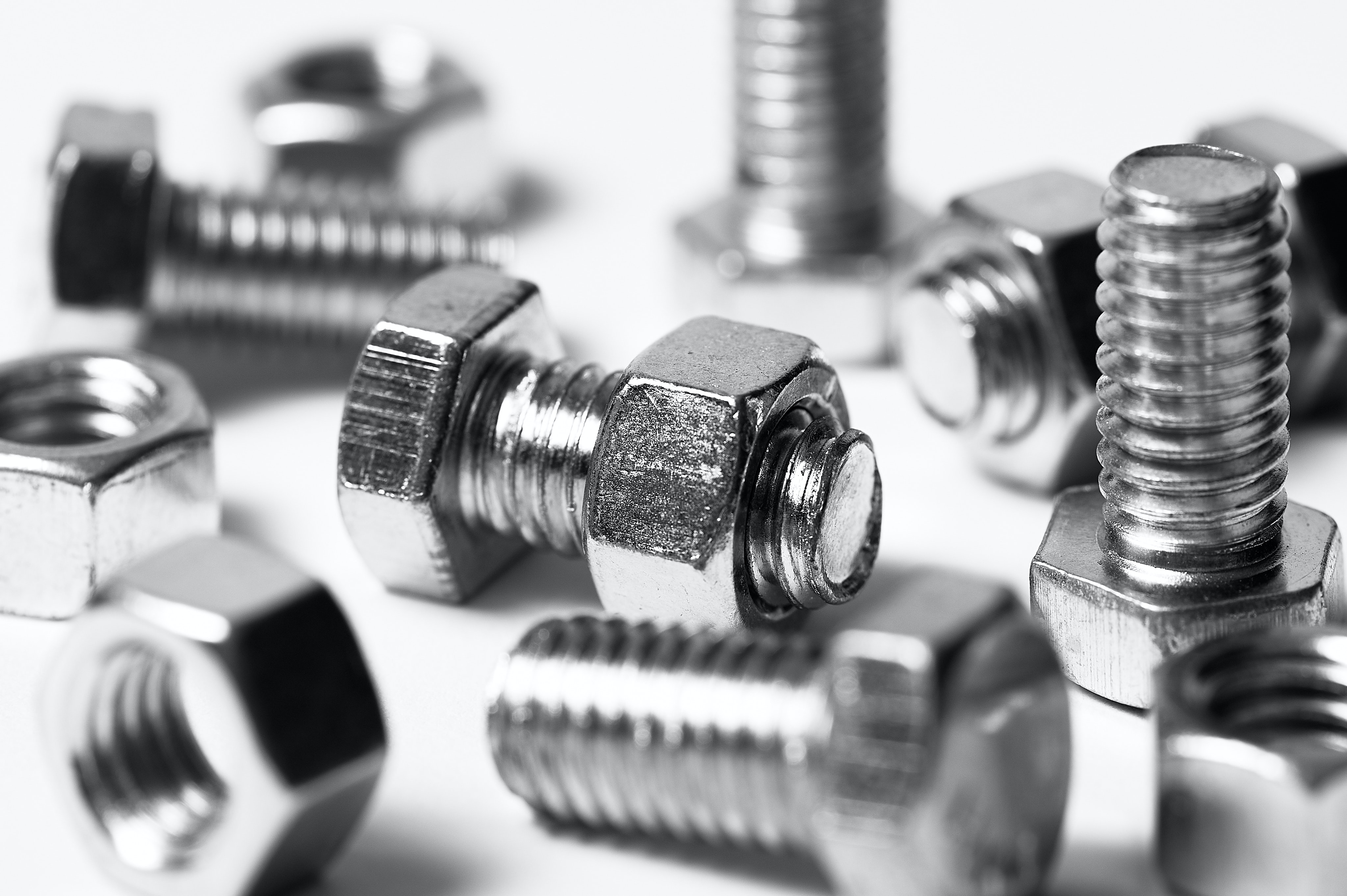silver nuts and bolts on a table; pre-employment assessment