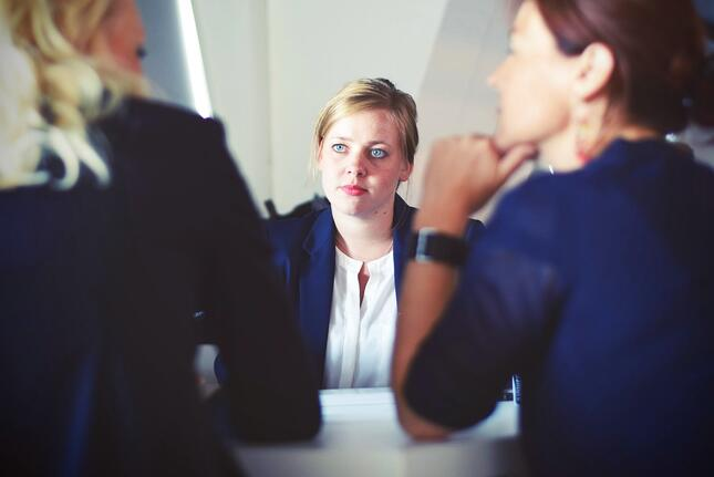 2 women taking an interview of a candidate;retention strategies for employees